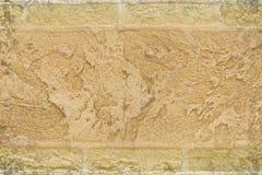 在砖背景的灰泥 免版税库存图片