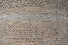 在砖背景的阿拉伯题字 免版税图库摄影