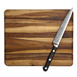 在砧板的刀子查出 免版税库存照片