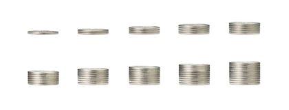 在硬币和堆1到10行的生长金钱图表银c 免版税库存图片