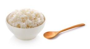 在碗和木匙子的米 免版税库存图片