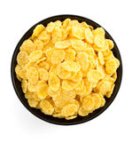 在碗的玉米片在白色 免版税库存照片