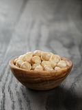 在碗的被剥皮的榛子 库存照片