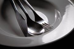 在碗的银器 免版税图库摄影