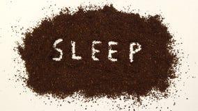 在碾碎的咖啡明白解说的睡眠 库存图片