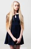 在礼服的时尚青少年的女性模型 库存图片
