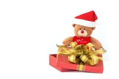 在礼物盒的圣诞老人熊 免版税图库摄影