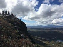 在祖父山顶部的远足者 免版税库存照片