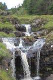 在神仙的水池的瀑布,斯凯岛小岛  库存照片