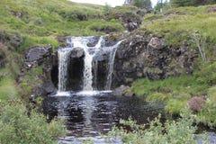 在神仙的水池的瀑布,斯凯岛小岛  免版税库存图片