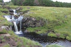 在神仙的水池的瀑布,斯凯岛小岛  库存图片