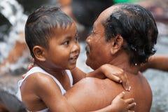 在神圣的圣洁泉水,巴厘岛的洗净 免版税库存图片