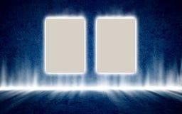在神奇发光的蓝色内部的两张海报 免版税库存图片