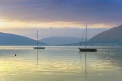在秋天日落的两条小船 库存图片