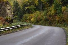 在秋天的乡下公路 库存照片