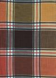 在秋季颜色的苏格兰纺织品 免版税库存照片