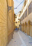 在科普特人的处所的狭窄的街道 免版税库存图片