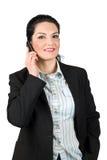 在移动电话的微笑的女商人谈话 库存照片