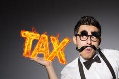 在税企业概念的滑稽的商人 库存图片