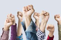 在空气举的小组拳头 免版税库存图片