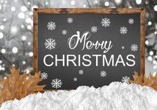 在空白的黑板的圣诞快乐有blurr森林的离开和 免版税库存图片