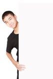 在空白纸片的亚裔少年男孩之后 图库摄影