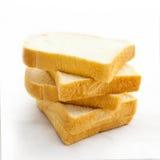 在空白背景查出的切的面包 免版税库存照片