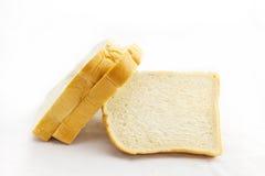 在空白背景查出的切的面包 库存照片