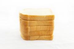 在空白背景查出的切的面包 库存图片