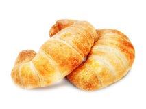 在空白背景查出的新鲜和鲜美新月形面包 免版税库存照片