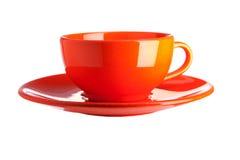 在空白背景查出的橙色杯子 库存照片