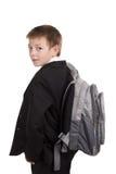 在空白背景查出的男小学生 免版税库存照片