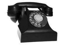 在空白背景查出的黑色减速火箭的电话 免版税库存照片
