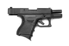 在空白背景查出的黑色枪 库存图片