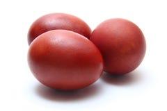 在空白背景的三个红皮蛋 免版税库存照片