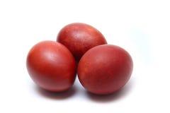 在空白背景的三个红皮蛋 免版税库存图片