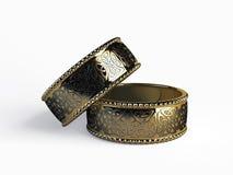在空白背景的二只金戒指 库存照片