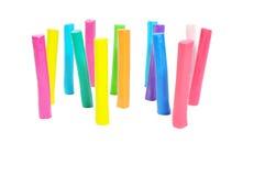 在空白背景的五颜六色的彩色塑泥棍子 图库摄影