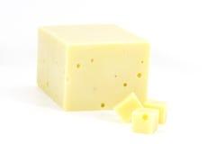 在空白背景的干酪块,   库存图片
