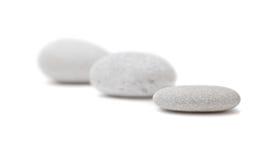 在空白背景的温泉石头 免版税库存图片