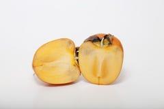在空白背景的片式柿子 免版税库存照片