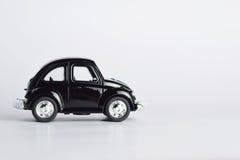 在空白背景的玩具汽车 库存图片