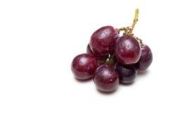 在空白背景的红葡萄 库存图片