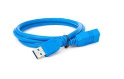 在空白背景的蓝色usb电缆 库存照片