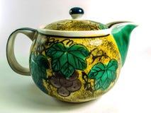 在空白背景的陶瓷茶壶 免版税图库摄影