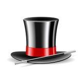 在空白背景的魔术帽子和魔术鞭子 库存照片