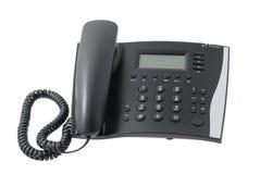 在空白背景的黑色电话 库存照片