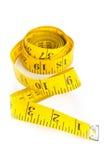 在空白背景的黄色评定磁带 免版税库存图片