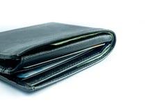 在空白背景的黑色钱包 库存图片