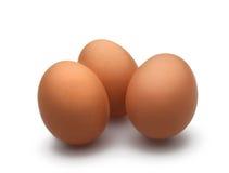 在空白背景的3个鸡蛋 免版税库存图片